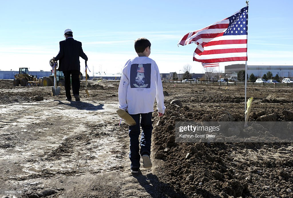 Kyle Andrew Crawford, 9, carries a shovel following Rick Crandall to the site where the Colorado Freedom Memorial will be built. Crawford is named after his uncle, Marin Lance Cpl. Andrew Riedel, who killed in Iraq in 2004. After 12 years, radio personality Rick Crandall is finally witnessing the dream of having a memorial built for Colorado's veterans, come true. A ground-breaking ceremony hosted by Crandall on a two-acre parcel of land near Buckley Air Force Base, is the start of the Colorado Freedom Memorial. The memorial, made of glass panels, will stand approximately 14 feet tall and 125 feet long and will have over 6,000 names etched in them of service members who have died in war.