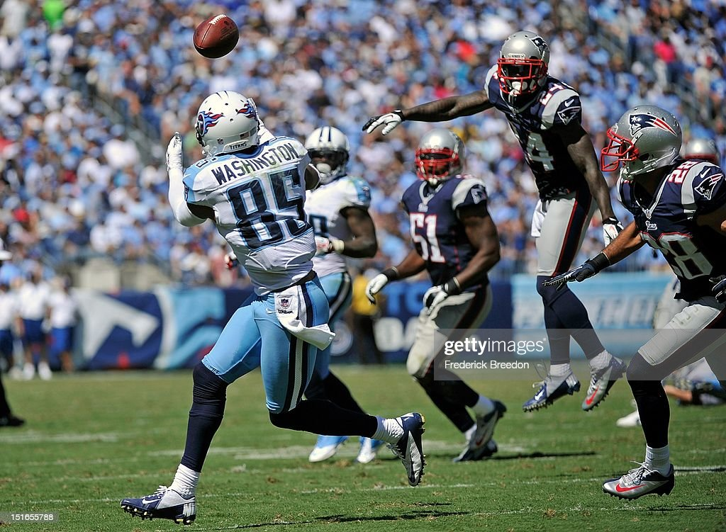 Kyle Arrington #24 and Steve Gregory #28 of the New England Patriots watch wide receiver <a gi-track='captionPersonalityLinkClicked' href=/galleries/search?phrase=Nate+Washington&family=editorial&specificpeople=748657 ng-click='$event.stopPropagation()'>Nate Washington</a> #85 of the Tennessee Titans cathch a touchdown pass during their season opener at LP Field on September 9, 2012 in Nashville, Tennessee.