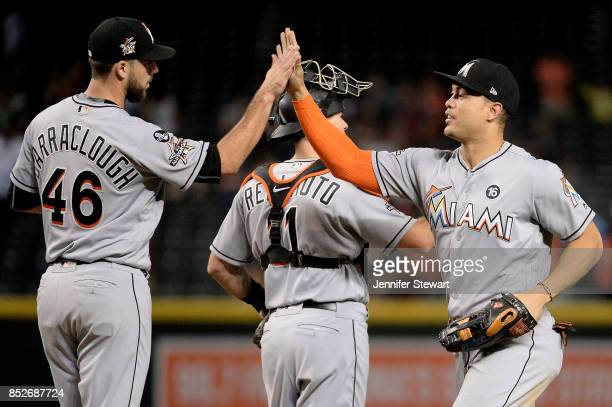 Kyle Barraclough and Giancarlo Stanton of the Miami Marlins celebrate after closing out the MLB game against the Arizona Diamondbacks at Chase Field...