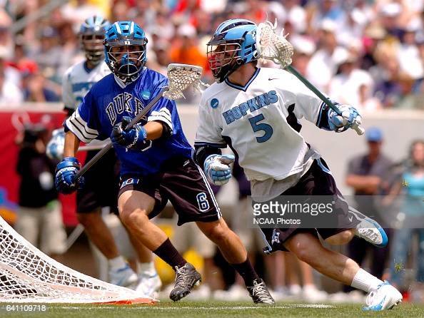 Kyle Barrie of Johns Hopkins drives to the goal while being defended by David Evans of Duke during the Division I Men's Lacrosse Championship help at...