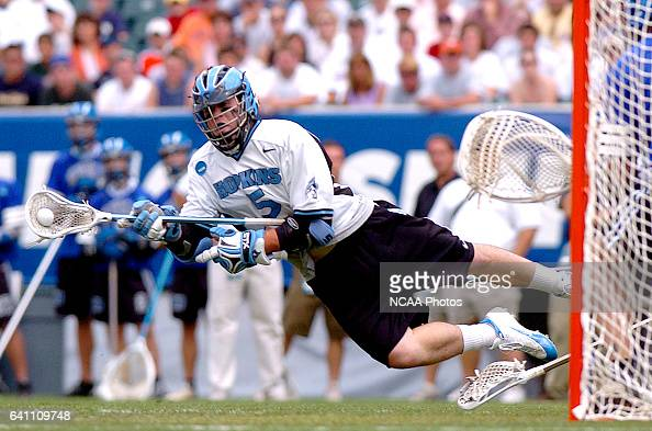 Kyle Barrie of Johns Hopkins takes a shot on goal as he is tripped up during the Division I Men's Lacrosse Championship help at Lincoln Financial...