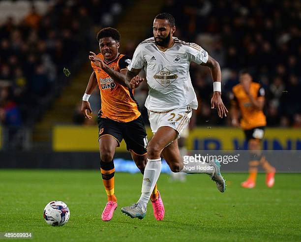 Kyle Bartley of Swansea City and Chuba Akpom of Hull City compete for the ball during the Capital One Cup third round match between Hull City and...