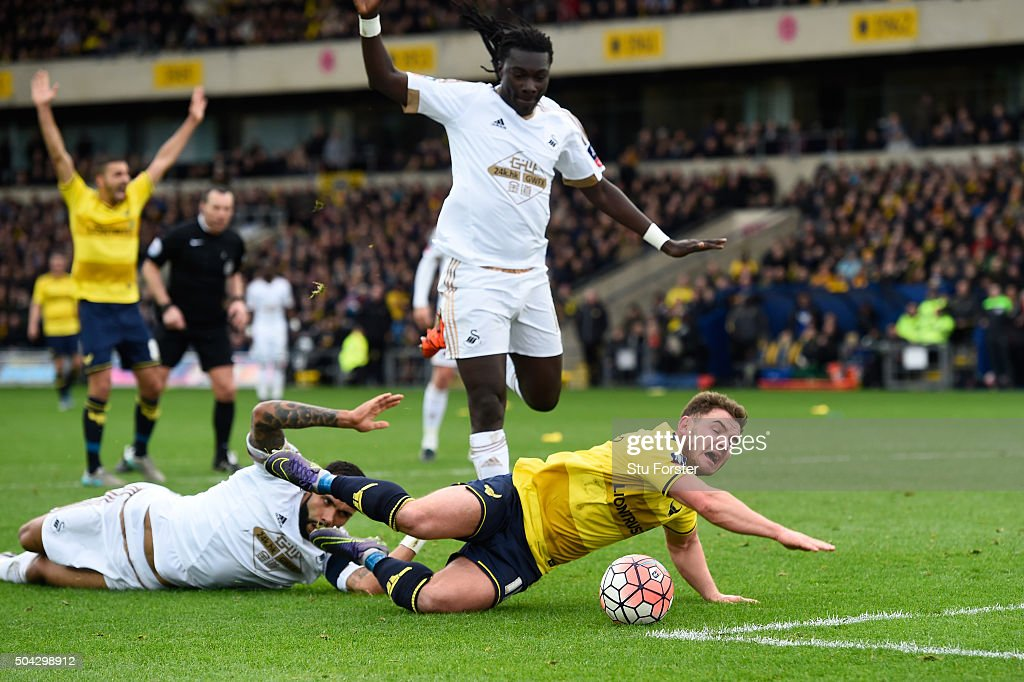 Kyle Bartley of Swansea City brings down Alex MacDonald of Oxford United to concede a penalty during The Emirates FA Cup third round match between Oxford United and Swansea City at the Kassam Stadium on January 10, 2016 in Oxford, England.