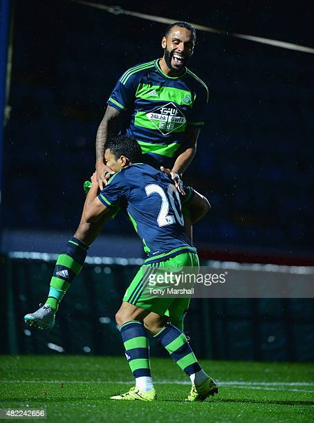 Kyle Bartley of Swansea City celebrates scoring a goal with Jefferson Montero during the Pre Season Friendly match between Reading and Swansea City...