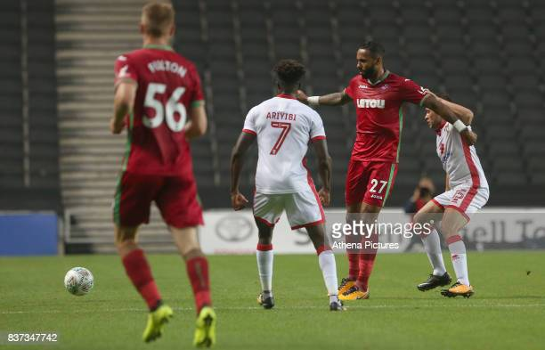 Kyle Bartley of Swansea City is marked by Gboly Ariyibi of MK Dons during the Carabao Cup Second Round match between MK Dons and Swansea City at...