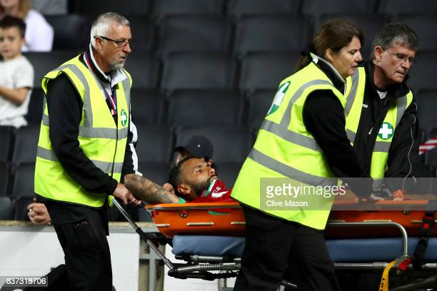 Kyle Bartley of Swansea City is taken off injured on a stretcher during the Carabao Cup Second Round match between Milton Keynes Dons and Swansea...