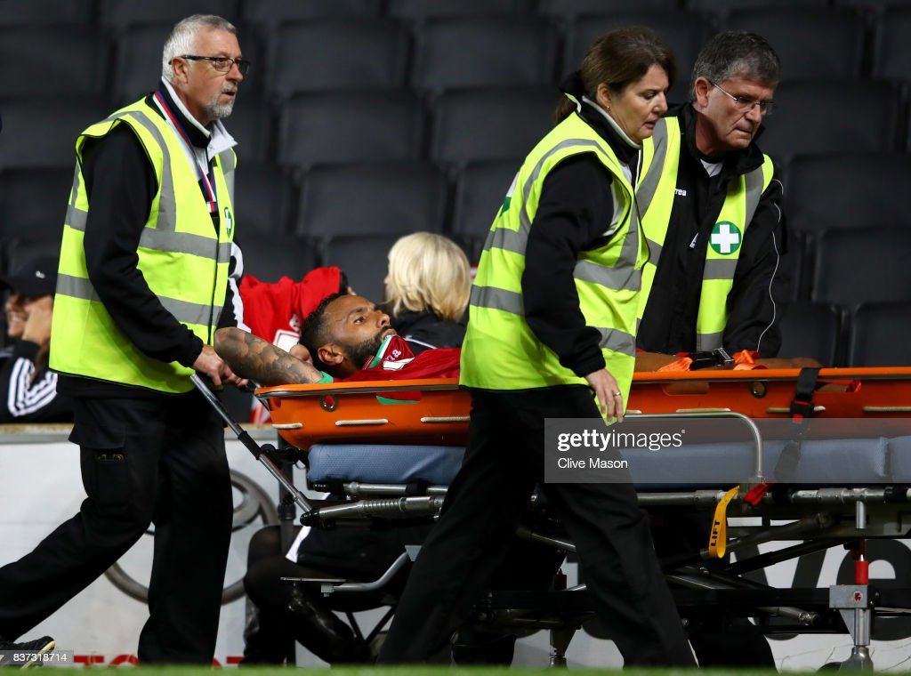 Kyle Bartley of Swansea City is taken off injured on a stretcher during the Carabao Cup Second Round match between Milton Keynes Dons and Swansea City at StadiumMK on August 22, 2017 in Milton Keynes, England.
