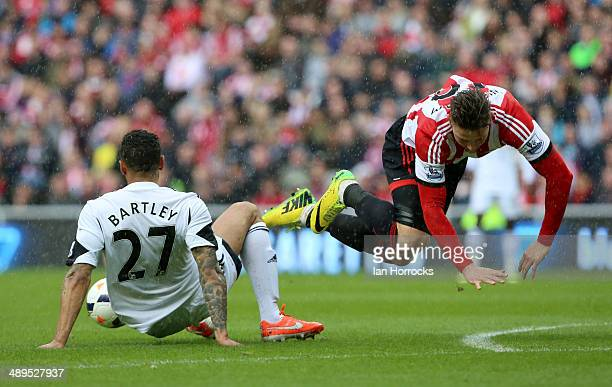 Kyle Bartley of Swansea City tackles Connor Newton of Sunderland during the Barclays Premier League match between Sunderland and Swansea City at The...