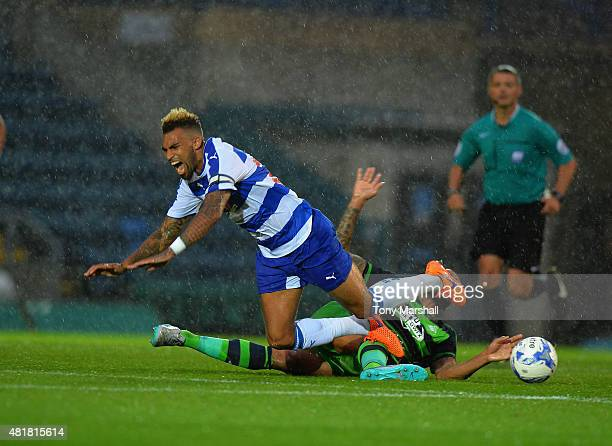 Kyle Bartley of Swansea City tackles Danny Williams of Reading during the Pre Season Friendly match between Reading and Swansea City at Adams Park on...