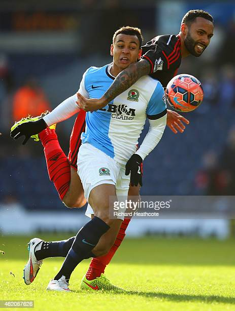 Kyle Bartley of Swansea City tangles with Joshua King of Blackburn Rovers during the FA Cup Fourth Round match between Blackburn Rovers and Swansea...
