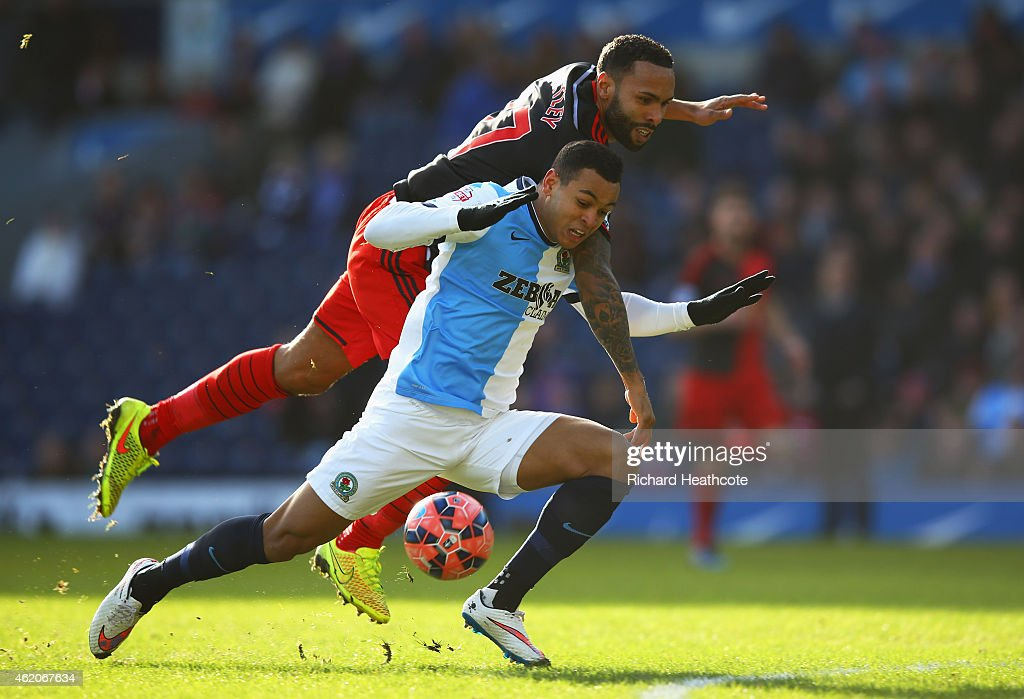 Kyle Bartley of Swansea City tangles with Joshua King of Blackburn Rovers during the FA Cup Fourth Round match between Blackburn Rovers and Swansea City at Ewood park on January 24, 2015 in Blackburn, England. The challenge results in a foul and red card for Bartley.