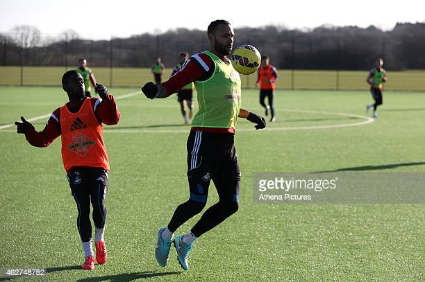 Kyle Bartley stops the ball with his chest marked by Nathan Dyer during a Swansea City training session at Fairwood training ground on February 4...
