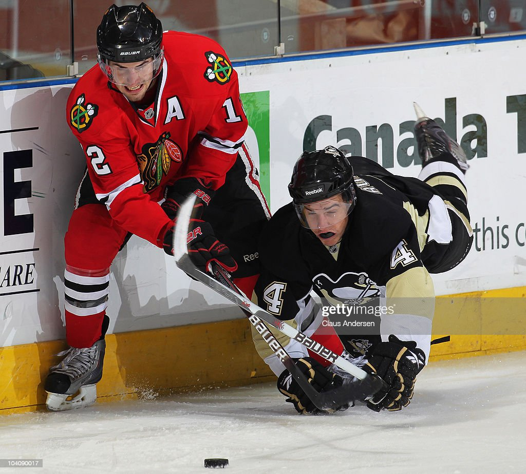 Kyle Beach #12 of the Chicago Black Hawks battles for the puck with Joe Rogalski #4 of the Pittsburgh Penguins in a game during the NHL Rookie Tournament on September 14,2010 at the John Labatt Centre in London,Ontario. The Hawks defeated the Penguins 9-5.
