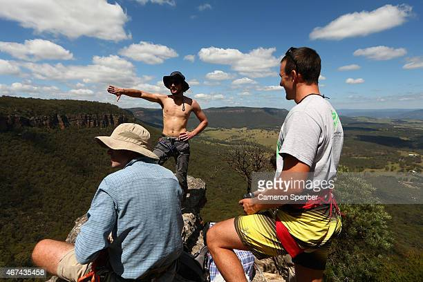 Kyle Beall of the United States discusses a highline with friends at Corroboree Walls in Mount Victoria on March 7 2015 in the Blue Mountains...