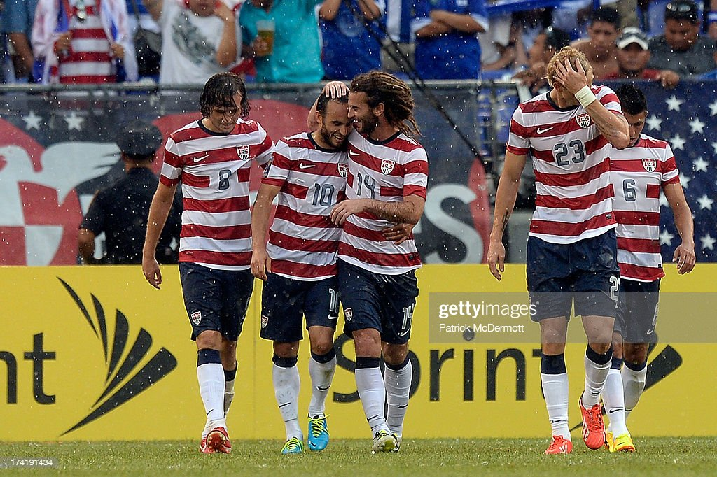 Kyle Beckerman #14 celebrates with Landon Donovan #10 of the United States after Mix Diskerud #8 scored a goal in the second half against El Salvador during the 2013 CONCACAF Gold Cup quarterfinal game at M&T Bank Stadium on July 21, 2013 in Baltimore, Maryland.