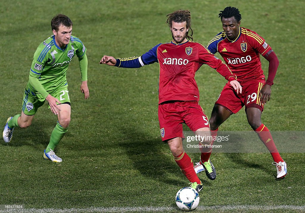 Kyle Beckerman #5 of Real Salt Lake attempts to control the ball ahead of Alex Caskey #27 of the Seattle Sounders during FC Tucson Desert Diamond Cup Championship match at Kino Sports Complex on February 23, 2013 in Tucson, Arizona. The Sounders defeated Real Salt Lake 1-0 to win the Championship.