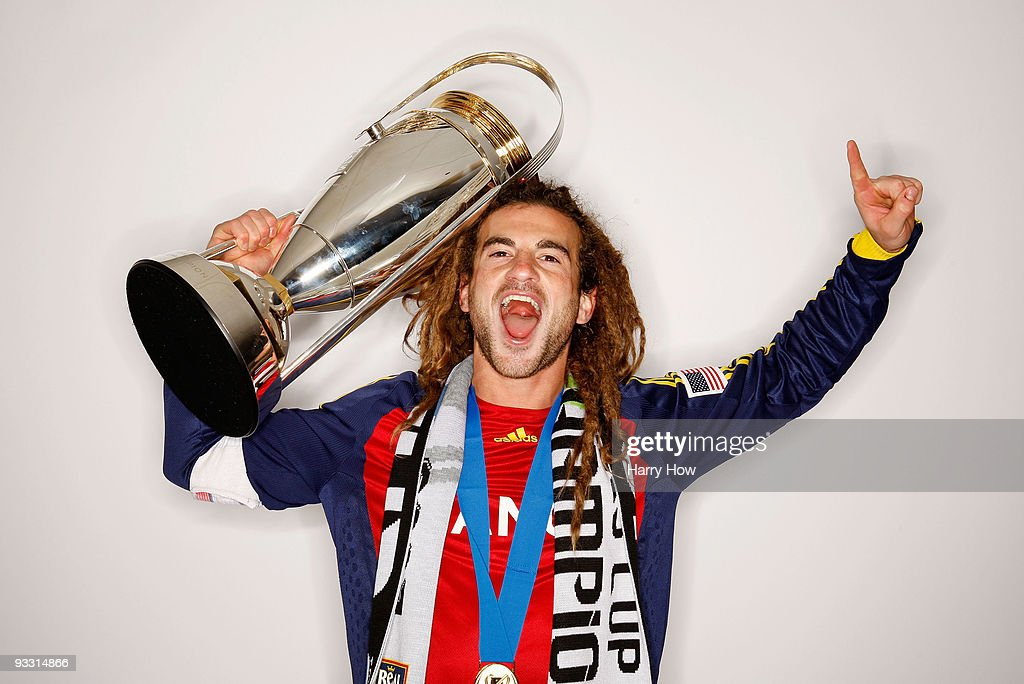 <a gi-track='captionPersonalityLinkClicked' href=/galleries/search?phrase=Kyle+Beckerman&family=editorial&specificpeople=578059 ng-click='$event.stopPropagation()'>Kyle Beckerman</a> #5 of Real Salt Lake poses with the Philip F. Anschutz MLS Cup trophy following their win in the MLS Cup final at Qwest Field on November 22, 2009 in Seattle, Washington.