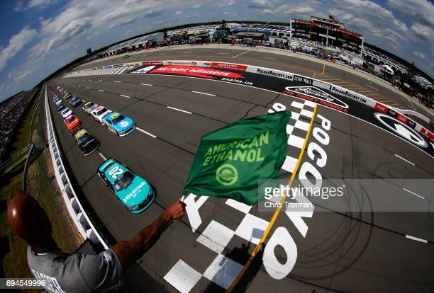 Kyle Benjamin driver of the Hisense Toyota leads the field to the green flag to start the NASCAR XFINITY Series Pocono Green 250 at Pocono Raceway on...