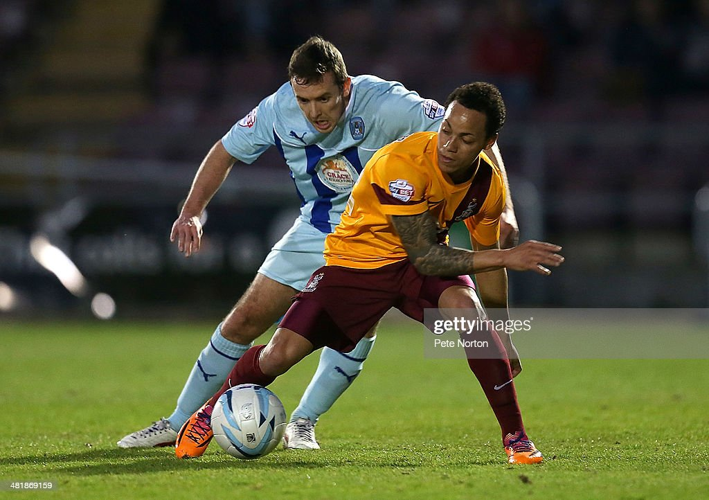 <a gi-track='captionPersonalityLinkClicked' href=/galleries/search?phrase=Kyle+Bennett&family=editorial&specificpeople=2108797 ng-click='$event.stopPropagation()'>Kyle Bennett</a> of Bradford City looks to control the ball watched by Blair Adams of Coventry City during the Sky Bet League One match between Covenrty City and Bradford City at Sixfields Stadium on April 1, 2014 in Northampton, England.