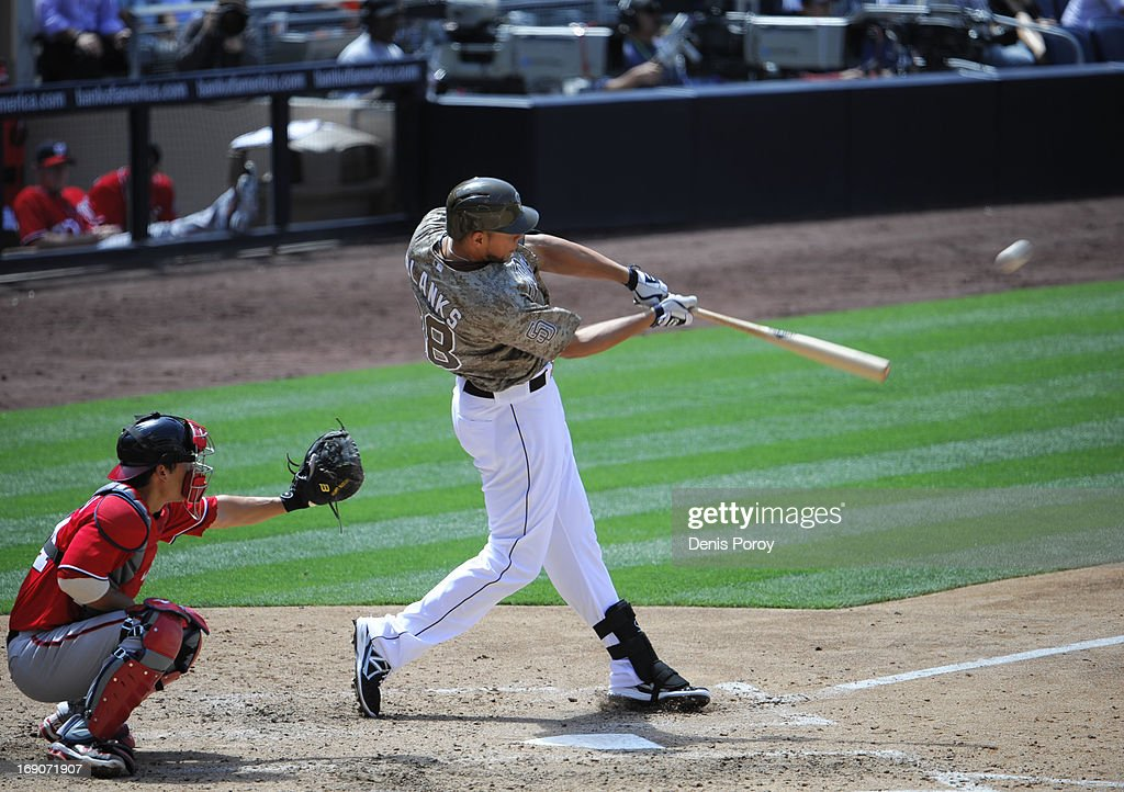 <a gi-track='captionPersonalityLinkClicked' href=/galleries/search?phrase=Kyle+Blanks&family=editorial&specificpeople=4901863 ng-click='$event.stopPropagation()'>Kyle Blanks</a> #88 of the San Diego Padres hits a two-run homer as <a gi-track='captionPersonalityLinkClicked' href=/galleries/search?phrase=Kurt+Suzuki&family=editorial&specificpeople=682702 ng-click='$event.stopPropagation()'>Kurt Suzuki</a> #24 of the Washington Nationals looks on during the fifth inning of a baseball game at Petco Park on May 19, 2013 in San Diego, California.