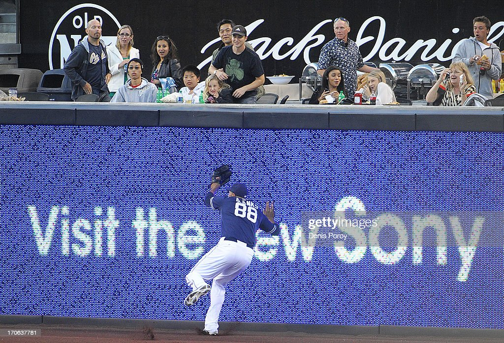 <a gi-track='captionPersonalityLinkClicked' href=/galleries/search?phrase=Kyle+Blanks&family=editorial&specificpeople=4901863 ng-click='$event.stopPropagation()'>Kyle Blanks</a> #88 of the San Diego Padres hits the wall as he makes a catch on a ball hit by Cliff Pennington #4 of the Arizona Diamondbacks during the second inning of a baseball game at Petco Park on June 15, 2013 in San Diego, California.