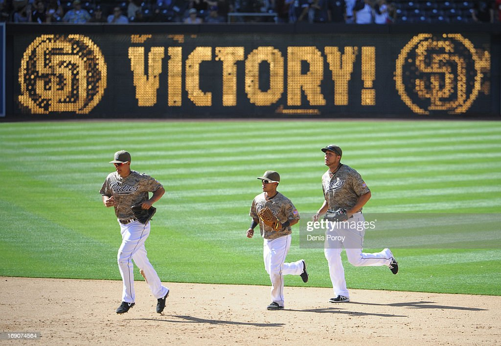 Kyle Blanks #88 of the San Diego Padres, left, Alexi Amarista #5, center, and Will Venable #25, right, run in from the outfield after the Padres beat the Washington Nationals 13-4 in a baseball game at Petco Park on May 19, 2013 in San Diego, California.