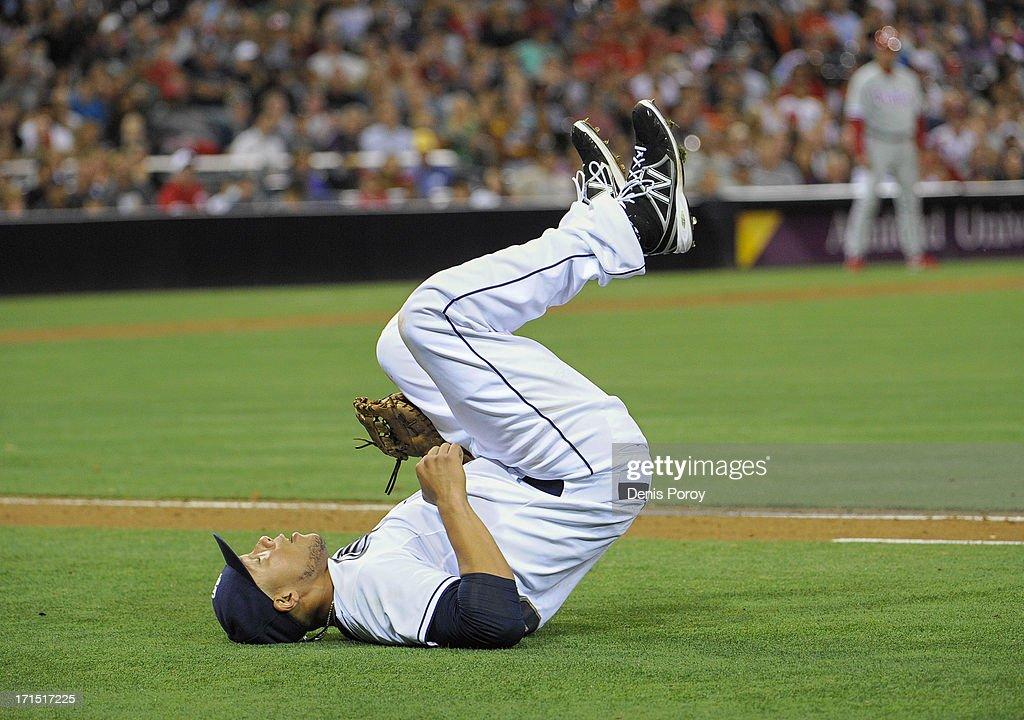 <a gi-track='captionPersonalityLinkClicked' href=/galleries/search?phrase=Kyle+Blanks&family=editorial&specificpeople=4901863 ng-click='$event.stopPropagation()'>Kyle Blanks</a> #88 of the San Diego Padres rolls on his back after losing a ball hit by Chase Utley #26 of the Philadelphia Phillies during the sixth inning of a baseball game against the Philadelphia Phillies at Petco Park on June 25, 2013 in San Diego, California. Blanks was charged with an error on the play.
