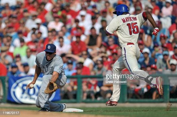 Kyle Blanks of the San Diego Padres stretches for the ball at first base to put out John Mayberry Jr #15 of the Philadelphia Phillies at Citizens...