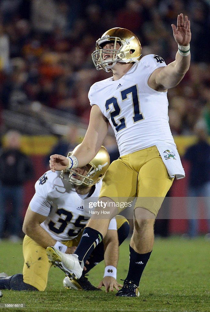 Kyle Brindza #27 of the Notre Dame Fighting Irish watches his fourth field goal for a 19-13 lead over the USC Trojans at Los Angeles Memorial Coliseum on November 24, 2012 in Los Angeles, California. Notre Dame would win 22-13.