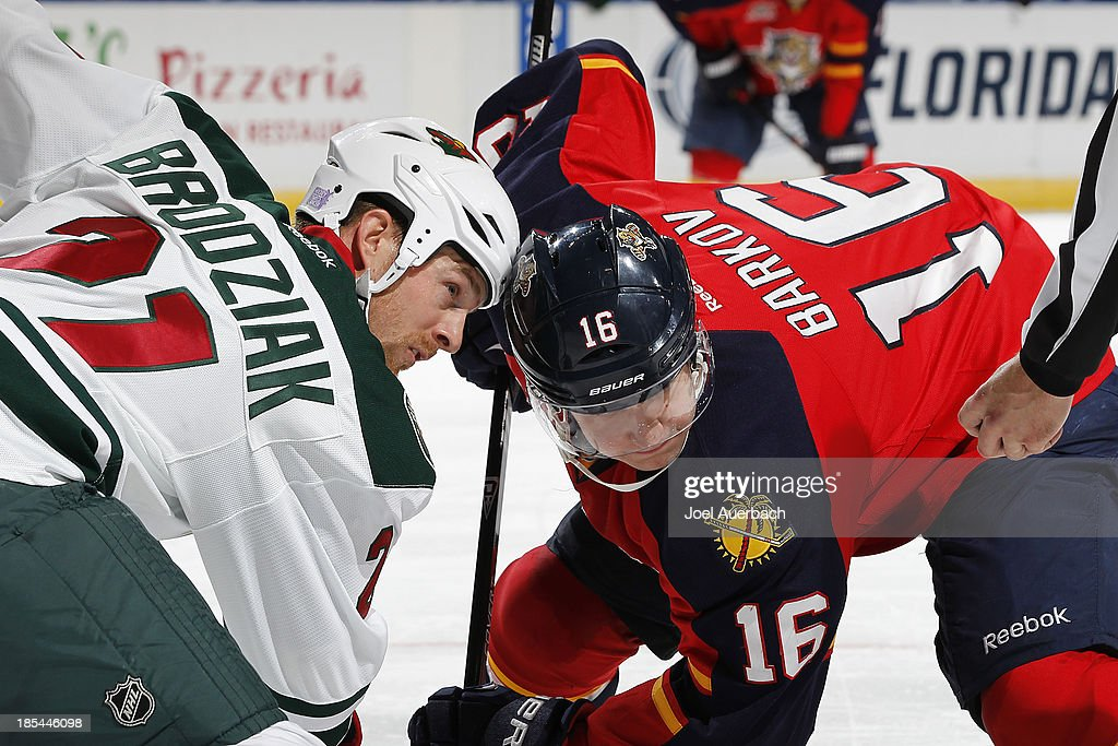 Kyle Brodziak #21 of the Minnesota Wild and Aleksander Barkov #16 of the Florida Panthers face-off during first period action at the BB&T Center on October 19, 2013 in Sunrise, Florida. The Panthers defeated the Wild 2-1 in a shoot-out.
