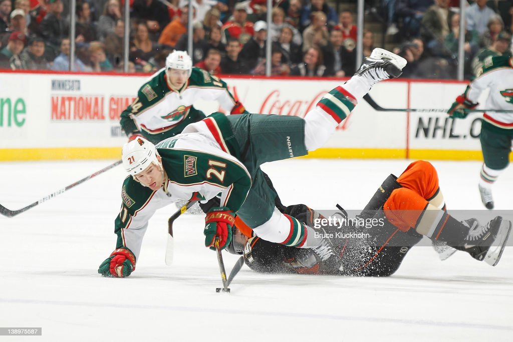 Kyle Brodziak of the Minnesota Wild and Ryan Getzlaf of the Anaheim Ducks collide during the game at the Xcel Energy Center on February 14 2012 in St...