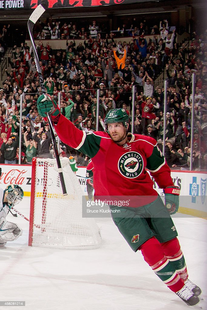 Kyle Brodziak of the Minnesota Wild celebrates after scoring a goal against the San Jose Sharks during the game on October 30 2014 at the Xcel Energy...