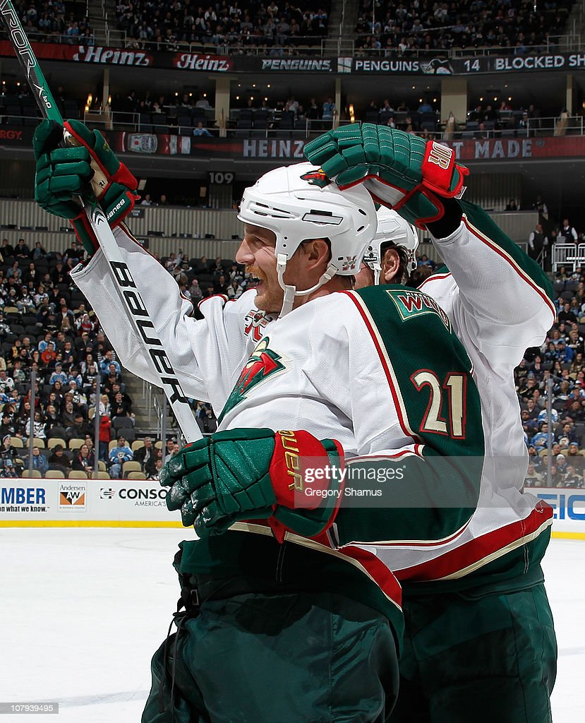 Kyle Brodziak of the Minnesota Wild celebrates his empty net goal against the Pittsburgh Penguins on January 8 2011 at Consol Energy Center in...