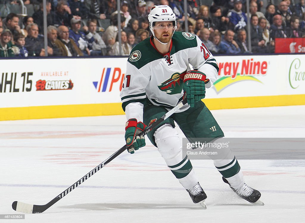 Kyle Brodziak of the Minnesota Wild skates against the Toronto Maple Leafs during an NHL game at the Air Canada Centre on March 23 2015 in Toronto...