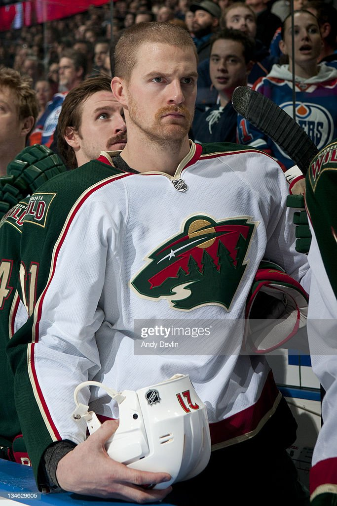 Kyle Brodziak of the Minnesota Wild stands for the national anthem prior to a game against the Edmonton Oilers at Rexall Place on November 30 2011 in...
