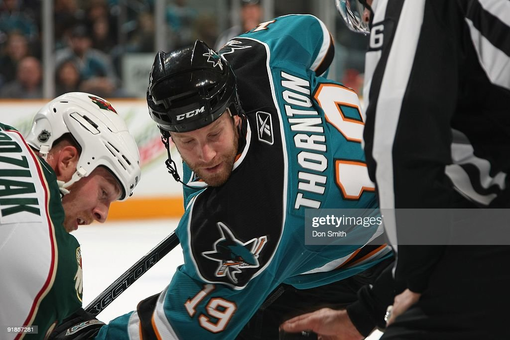 Kyle Brodziak of the Minnesota Wild takes a faceoff against Joe Thornton of the San Jose Sharks during an NHL game on October 10th 2009 at HP...