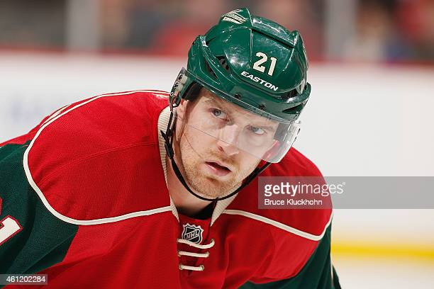 Kyle Brodziak of the Minnesota Wild waits for play to resume during the game against the San Jose Sharks on January 6 2015 at the Xcel Energy Center...