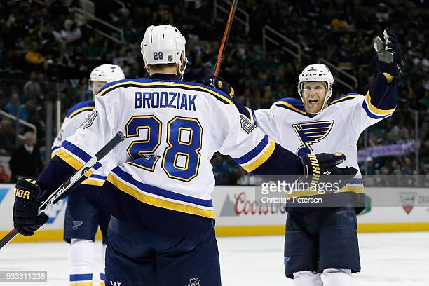 Kyle Brodziak of the St Louis Blues celebrates with Carl Gunnarsson after his first goal in game four of the Western Conference Finals against the...