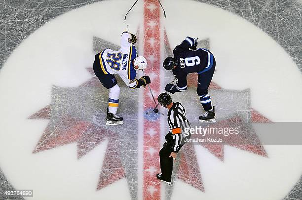 Kyle Brodziak of the St Louis Blues takes a second period faceoff against Andrew Copp of the Winnipeg Jets at the MTS Centre on October 18 2015 in...