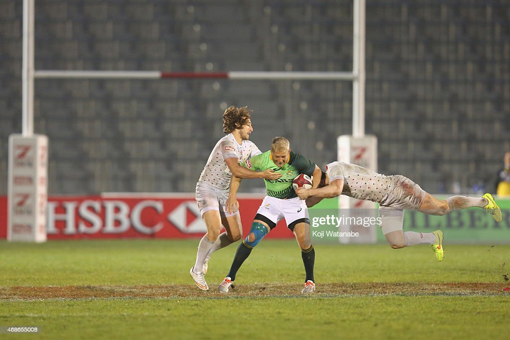 <a gi-track='captionPersonalityLinkClicked' href=/galleries/search?phrase=Kyle+Brown+-+Rugby+Player&family=editorial&specificpeople=5870383 ng-click='$event.stopPropagation()'>Kyle Brown</a> #6 of South Africa (C) gets tackled by Dan Bibby #7 and Charlie Hayter #2 of England during the Tokyo Sevens, round Seven of the HSBC Sevens World Series at the Prince Chichibu Memorial Ground on April 5, 2015 in Tokyo, Japan.