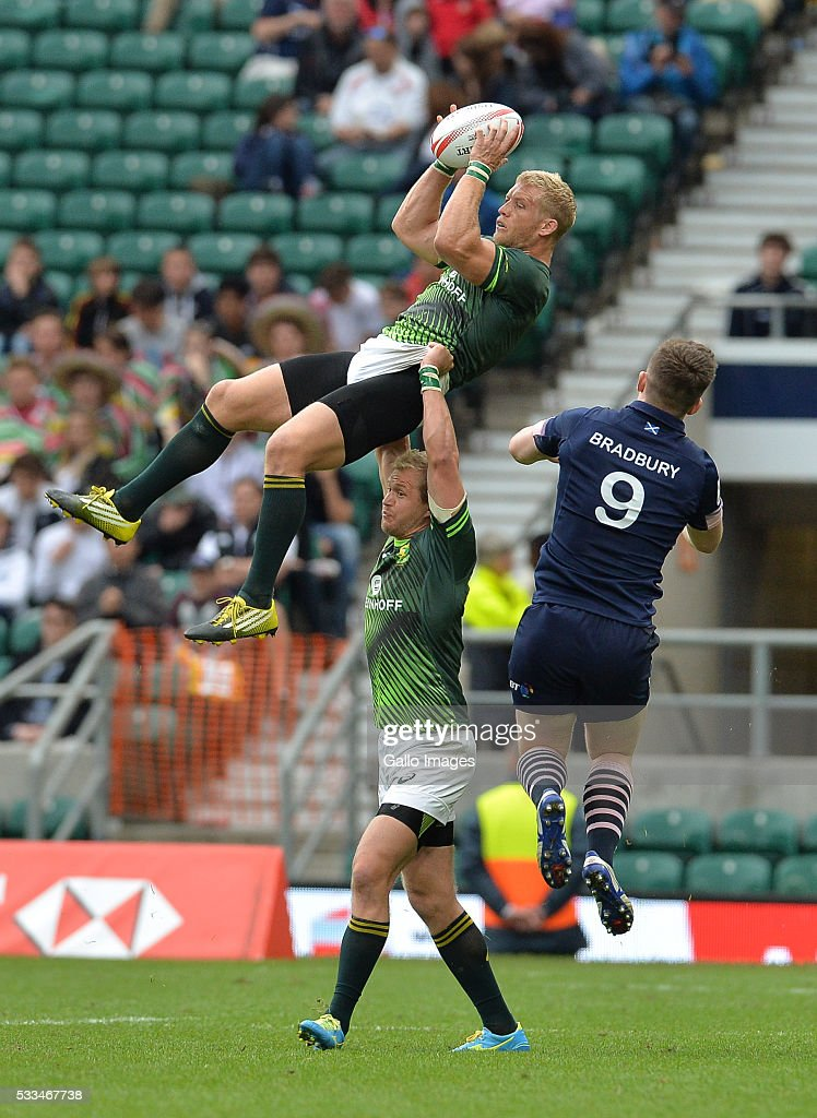 <a gi-track='captionPersonalityLinkClicked' href=/galleries/search?phrase=Kyle+Brown+-+Rugby+Player&family=editorial&specificpeople=5870383 ng-click='$event.stopPropagation()'>Kyle Brown</a> of South Africa is lifted high in the air by Philip Snyman, captain of South Africa during the cup final match between South Africa and Scotland on day 2 of the HSBC World Rugby Sevens Series London at Twickenham Stadium on May 22 in London, England.