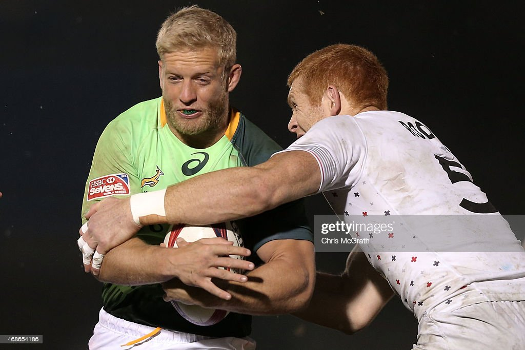 <a gi-track='captionPersonalityLinkClicked' href=/galleries/search?phrase=Kyle+Brown+-+Rugby+Player&family=editorial&specificpeople=5870383 ng-click='$event.stopPropagation()'>Kyle Brown</a> #6 of South Africa is tackled by James Rodwell #5 of England during the Cup Final between England and South Africa on day two of the Tokyo Sevens Rugby 2015 at Chichibunomiya Rugby Stadium on April 5, 2015 in Tokyo, Japan.