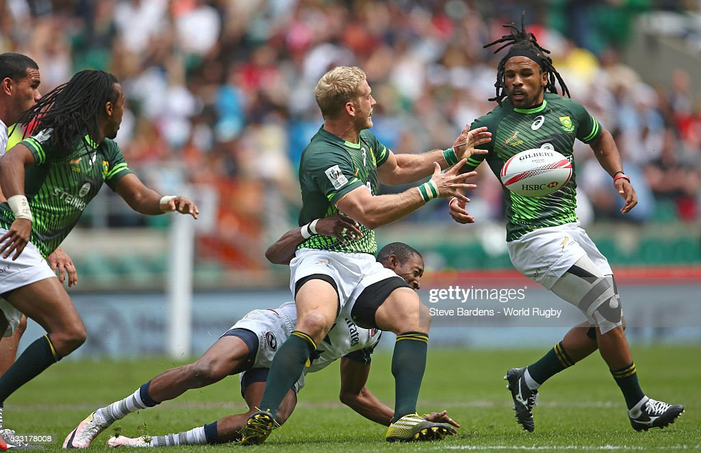 <a gi-track='captionPersonalityLinkClicked' href=/galleries/search?phrase=Kyle+Brown+-+Rugby+Player&family=editorial&specificpeople=5870383 ng-click='$event.stopPropagation()'>Kyle Brown</a> of South Africa passes the ball to Rosko Specman during the pool round match between South Africa and USA during the HSBC London Sevens at Twickenham Stadium on May 21, 2016 in London, United Kingdom.