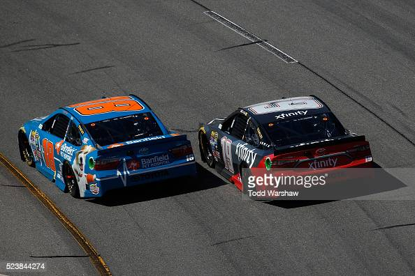 Kyle Busch driver of the Banfield Toyota races Carl Edwards driver of the XFINITY Toyota during the NASCAR Sprint Cup Series TOYOTA OWNERS 400 at...