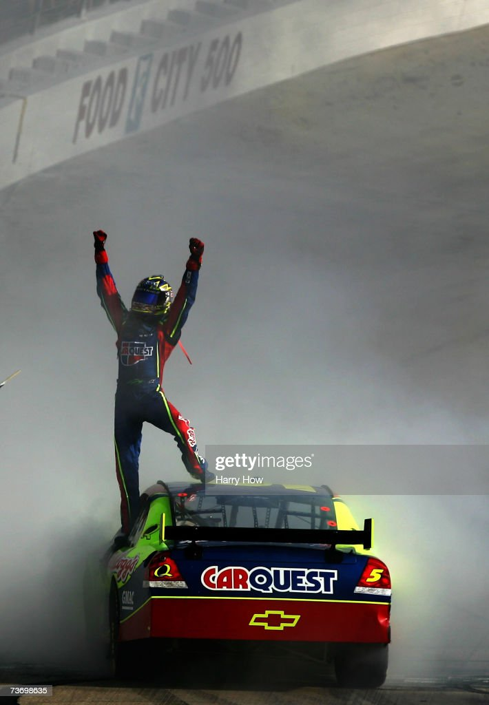 Kyle Busch driver of the Carquest/Kellogg's Chevrolet celebrates after winning the NASCAR Nextel Cup Series Food City 500 at Bristol Motor Speedway...