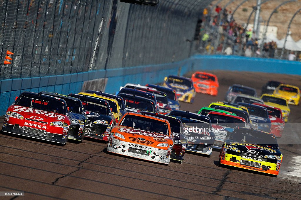 Kyle Busch driver of the Combos Toyota leads the field on a restart during of the Subway Fresh Fit 500 at Phoenix International Raceway on February...