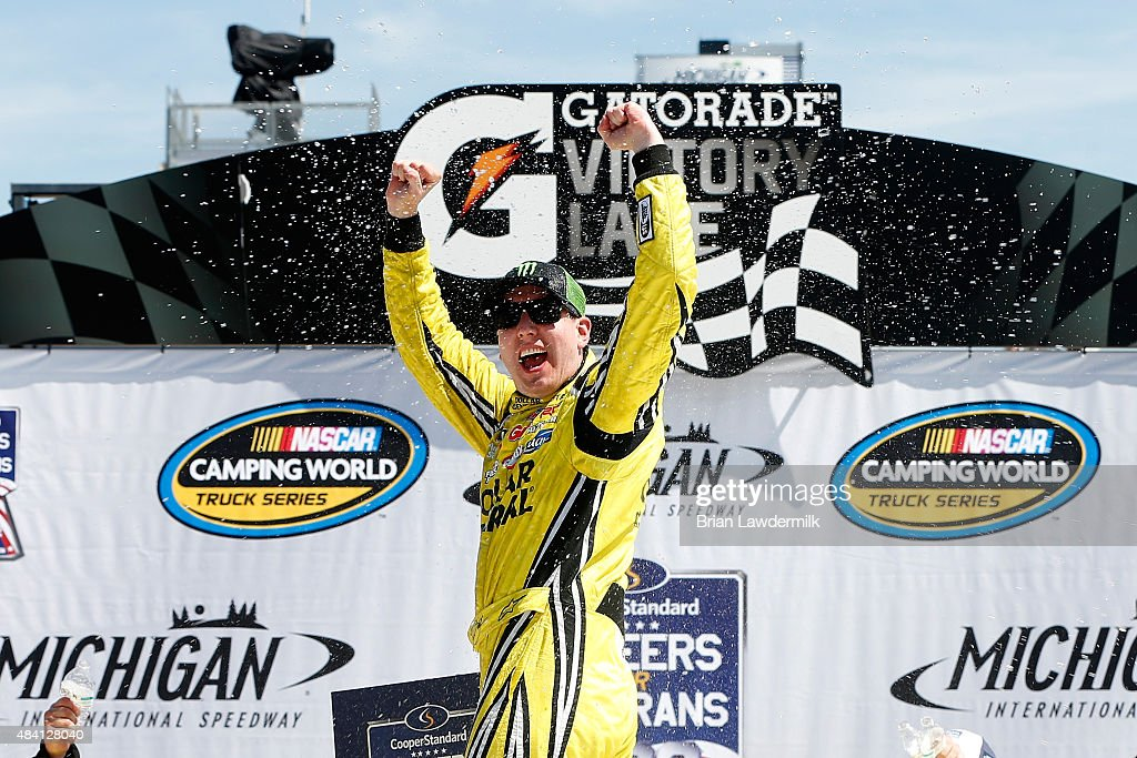 Kyle Busch driver of the Dollar General Toyota celebrates in victory lane after winning the NASCAR Camping World Truck Series Careers for Veterans...