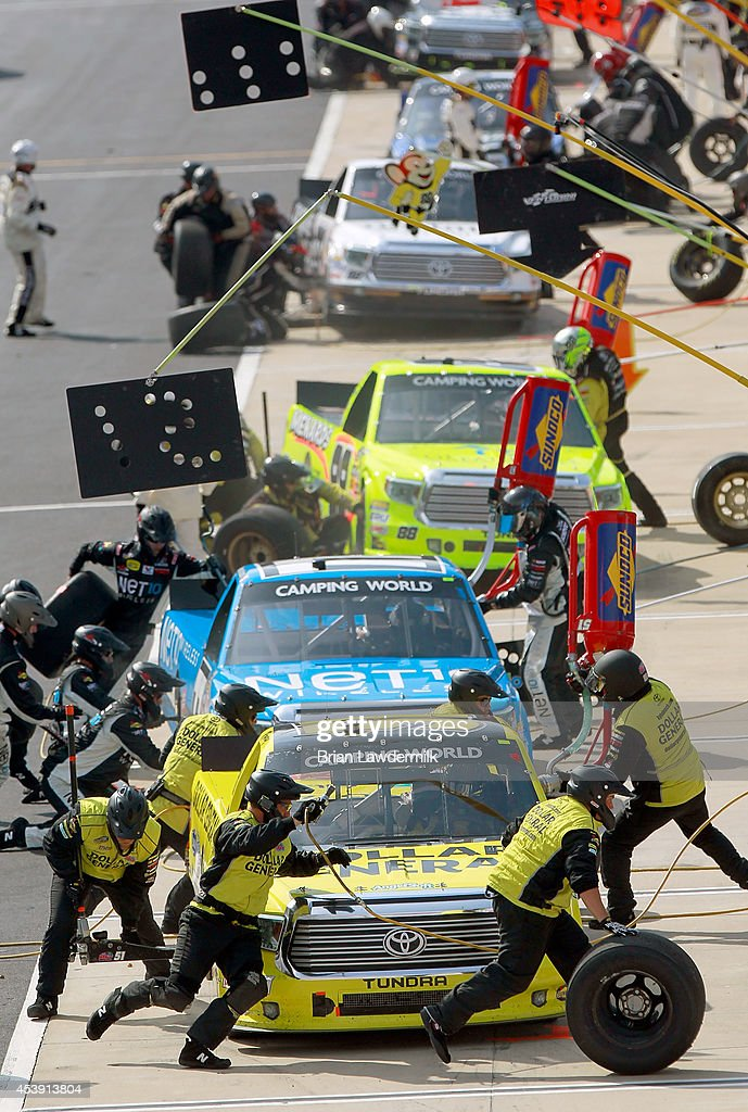 <a gi-track='captionPersonalityLinkClicked' href=/galleries/search?phrase=Kyle+Busch&family=editorial&specificpeople=211123 ng-click='$event.stopPropagation()'>Kyle Busch</a>, driver of the #51 Dollar General Toyota, comes in for a pit stop during the NASCAR Camping World Truck Series UNOH 200 presented by ZLOOP at Bristol Motor Speedway on August 21, 2014 in Bristol, Tennessee.