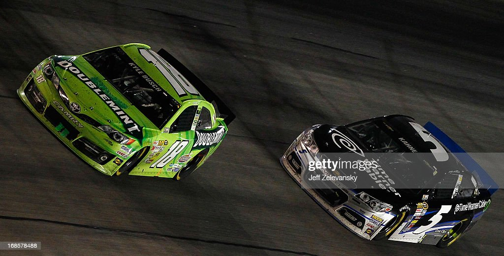 Kyle Busch, driver of the #18 Double Mint Gum Toyota, leads Kasey Kahne, driver of the #5 Time Warner Cable Chevrolet, during the NASCAR Sprint Cup Series Bojangles' Southern 500 at Darlington Raceway on May 11, 2013 in Darlington, South Carolina.