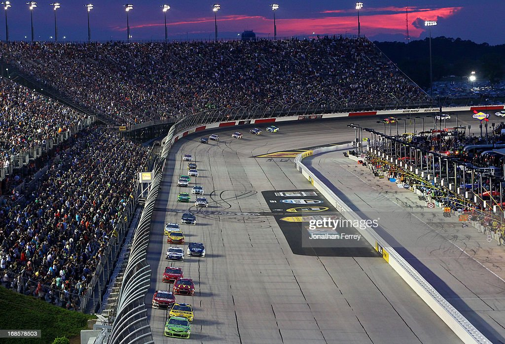 Kyle Busch, driver of the #18 Double Mint Gum Toyota, leads the field during the NASCAR Sprint Cup Series Bojangles' Southern 500 at Darlington Raceway on May 11, 2013 in Darlington, South Carolina.
